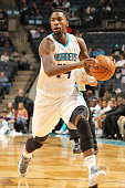 Michael KiddGilchrist of the Charlotte Hornets drives against the Indiana Pacers during the game at the Time Warner Cable Arena on October 23 2014 in...
