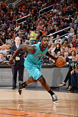 Michael KiddGilchrist of the Charlotte Hornets drives against the Phoenix Suns on November 14 2014 at US Airways Center in Phoenix Arizona NOTE TO...