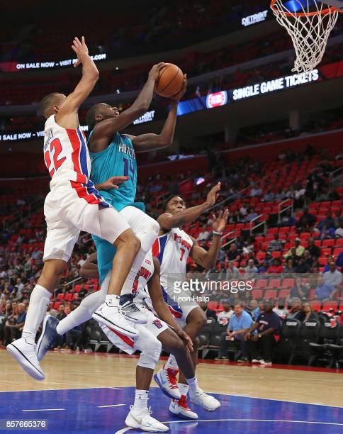 Michael KiddGilchrist of the Charlotte Hornets drives the ball to the basket as Avery Bradley of the Detroit Pistons defends during the fourth...