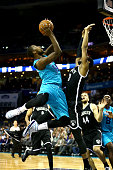 Michael KiddGilchrist of the Charlotte Hornets drives to the basket against Brandon Davies of the Brooklyn Nets during their game at Time Warner...