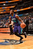 Michael KiddGilchrist of the Charlotte Hornets drives to the basket against the Orlando Magic on January 3 2015 at Amway Center in Orlando Florida...
