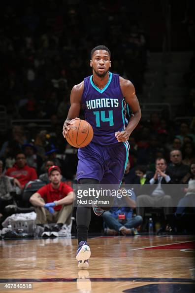 Michael KiddGilchrist of the Charlotte Hornets drives to the basket against the Washington Wizards during the game on March 27 2015 at Verizon Center...