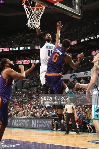 Michael KiddGilchrist of the Charlotte Hornets dunks against the against the Phoenix Suns on March 26 2017 at Spectrum Center in Charlotte North...