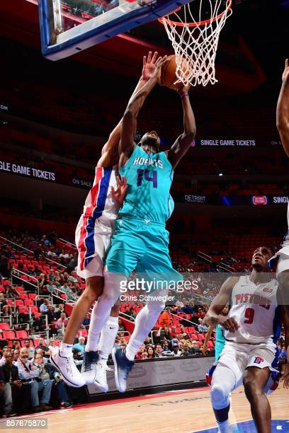 Michael KiddGilchrist of the Charlotte Hornets goes to the basket against the Detroit Pistons during a preseason game on October 4 2017 at The Palace...