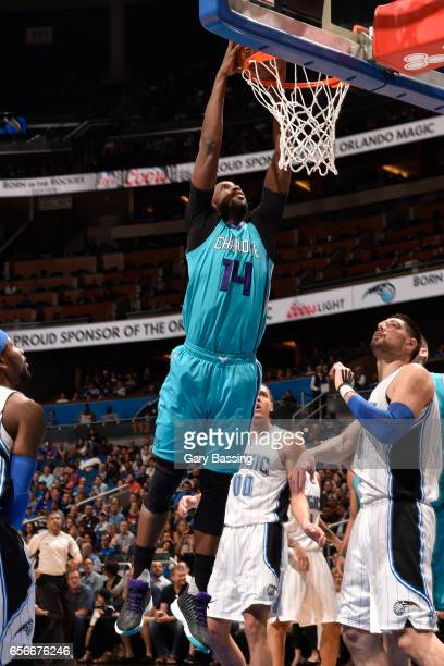 Michael KiddGilchrist of the Charlotte Hornets goes up for a dunk against the Orlando Magic on March 22 2017 at the Amway Center in Orlando Florida...