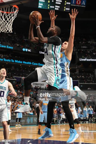 Michael KiddGilchrist of the Charlotte Hornets goes up for a lay up against the Denver Nuggets on March 31 2017 at Spectrum Center in Charlotte North...