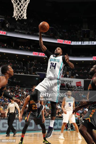 Michael KiddGilchrist of the Charlotte Hornets goes up for a shot during a game against the Atlanta Hawks on March 20 2017 at Spectrum Center in...