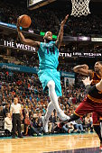 Michael KiddGilchrist of the Charlotte Hornets grabs the rebound against the Cleveland Cavaliers during the game at the Time Warner Cable Arena on...
