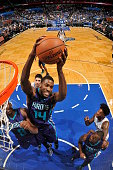 Michael KiddGilchrist of the Charlotte Hornets grabs the rebound against the Orlando Magic on January 3 2015 at Amway Center in Orlando Florida NOTE...
