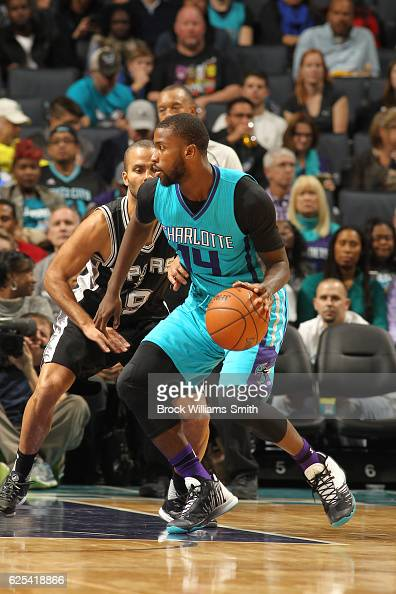 Michael KiddGilchrist of the Charlotte Hornets handles the ball during a game against the San Antonio Spurs on November 23 2016 at the Spectrum...