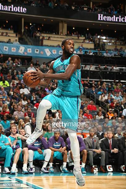 Michael KiddGilchrist of the Charlotte Hornets handles the ball against Cleveland Cavaliers during the game at the Time Warner Cable Arena on January...