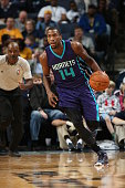 Michael KiddGilchrist of the Charlotte Hornets handles the ball against the Memphis Grizzlies during the game on December 12 2014 at FedExForum in...