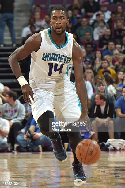 Michael KiddGilchrist of the Charlotte Hornets handles the ball against the Detroit Pistons on March 8 2015 at The Palace of Auburn Hills in Auburn...