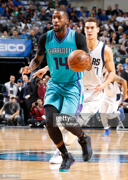 Michael KiddGilchrist of the Charlotte Hornets handles the ball against the Dallas Mavericks on December 5 2016 at the American Airlines Center in...