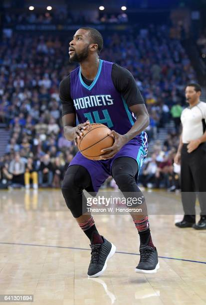 Michael KiddGilchrist of the Charlotte Hornets looka to shoot against the Golden State Warriors during an NBA basketball game at ORACLE Arena on...