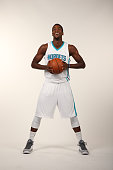 Michael KiddGilchrist of the Charlotte Hornets pose for their 1st ever media day at Time Warner Cable Arena on September 29 2014 in Charlotte North...