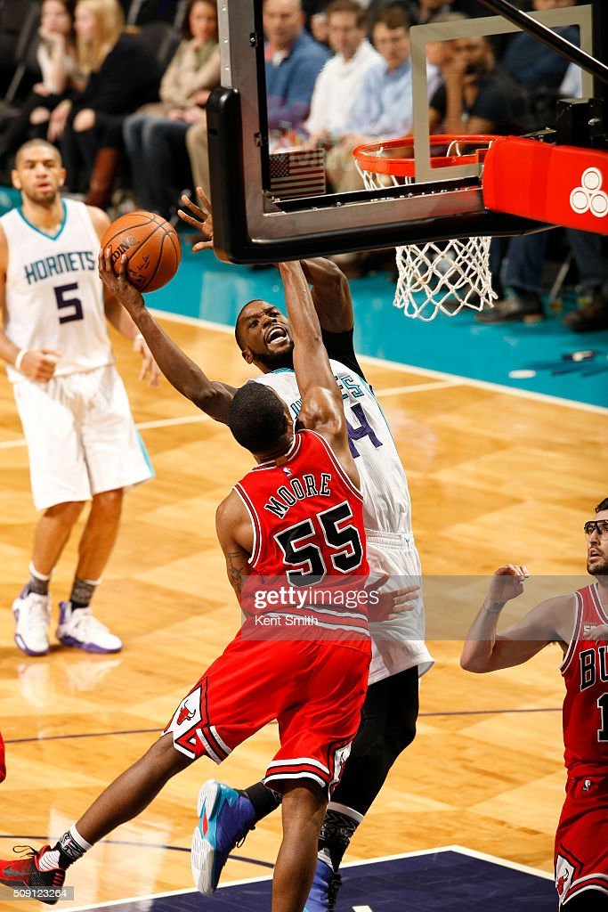 <a gi-track='captionPersonalityLinkClicked' href=/galleries/search?phrase=Michael+Kidd-Gilchrist&family=editorial&specificpeople=8526214 ng-click='$event.stopPropagation()'>Michael Kidd-Gilchrist</a> #14 of the Charlotte Hornets shoots against <a gi-track='captionPersonalityLinkClicked' href=/galleries/search?phrase=E%27Twaun+Moore&family=editorial&specificpeople=4877476 ng-click='$event.stopPropagation()'>E'Twaun Moore</a> #55 of the Chicago Bulls during the game at the Time Warner Cable Arena on February 06, 2016 in Charlotte, North Carolina.