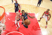 Michael KiddGilchrist of the Charlotte Hornets shoots against Marcin Gortat of the Washington Wizards during a game at the Verizon Center on March 27...