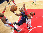 Michael KiddGilchrist of the Charlotte Hornets shoots against Nene and Paul Pierce of the Washington Wizards during a game at the Verizon Center on...