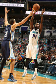 Michael KiddGilchrist of the Charlotte Hornets shoots against Tayshaun Prince of the Memphis Grizzlies during the game at the Time Warner Cable Arena...