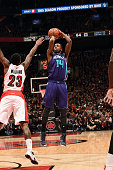 Michael KiddGilchrist of the Charlotte Hornets shoots against the Toronto Raptors on January 8 2015 at the Air Canada Centre in Toronto Ontario...