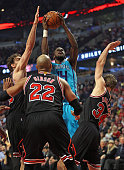 Michael KiddGilchrist of the Charlotte Hornets shoots over Paul Gasol Taj Gibson and Mike Dunleavy of the Chicago Bulls at the United Center on March...