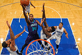 Michael KiddGilchrist of the Charlotte Hornets shoots the ball against the Orlando Magic during a preseason game on October 3 2015 at Amway Center in...