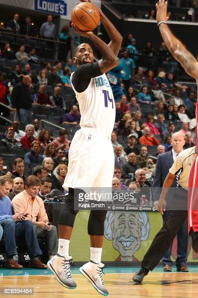 Michael KiddGilchrist of the Charlotte Hornets shoots the ball against the Detroit Pistons on December 7 2016 at Spectrum Center in Charlotte North...