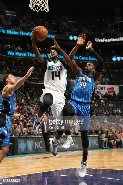 Michael KiddGilchrist of the Charlotte Hornets shoots the ball against the Orlando Magic on December 9 2016 at Spectrum Center in Charlotte North...