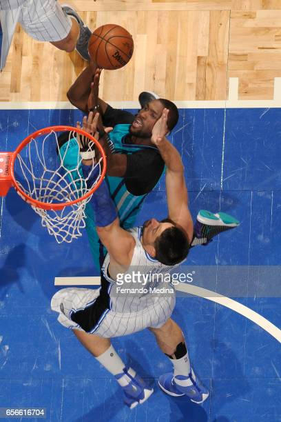 Michael KiddGilchrist of the Charlotte Hornets shoots the ball against the Orlando Magic on March 22 2017 at Amway Center in Orlando Florida NOTE TO...