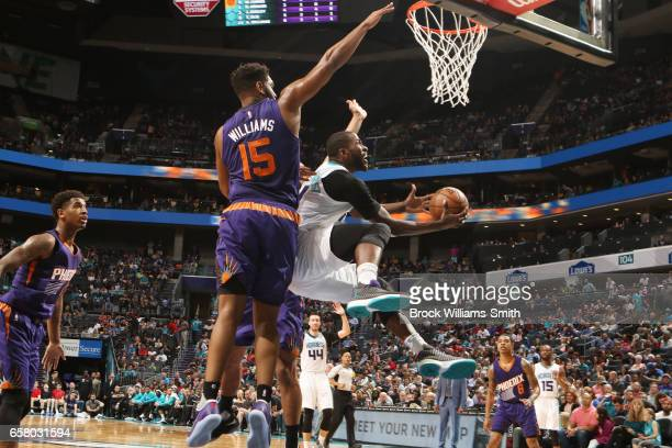 Michael KiddGilchrist of the Charlotte Hornets shoots the ball against the Phoenix Suns on March 26 2017 at Spectrum Center in Charlotte North...