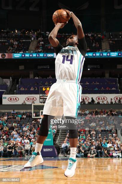 Michael KiddGilchrist of the Charlotte Hornets shoots the ball against the Denver Nuggets on March 31 2017 at Spectrum Center in Charlotte North...