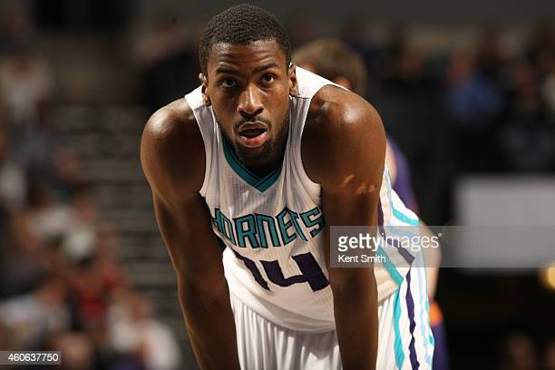 Michael KiddGilchrist of the Charlotte Hornets stands on the court against the Phoenix Suns at the Time Warner Cable Arena on December 17 2014 in...
