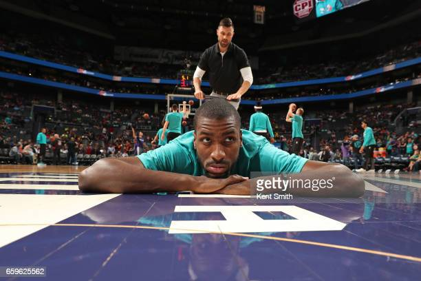 Michael KiddGilchrist of the Charlotte Hornets stretches before a game against the Cleveland Cavaliers on March 24 2017 at the Spectrum Center in...