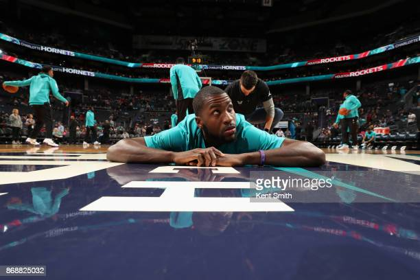 Michael KiddGilchrist of the Charlotte Hornets stretches before the game against the Houston Rockets on October 27 2017 at Spectrum Center in...