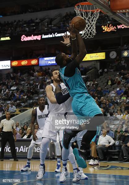 Michael KiddGilchrist of the Charlotte Hornets takes a shot against the Dallas Mavericks in the first half at American Airlines Center on December 5...