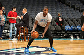 Michael KiddGilchrist of the Charlotte Hornets warms up before the game against the Boston Celtics on December 23 2015 at Time Warner Cable Arena in...
