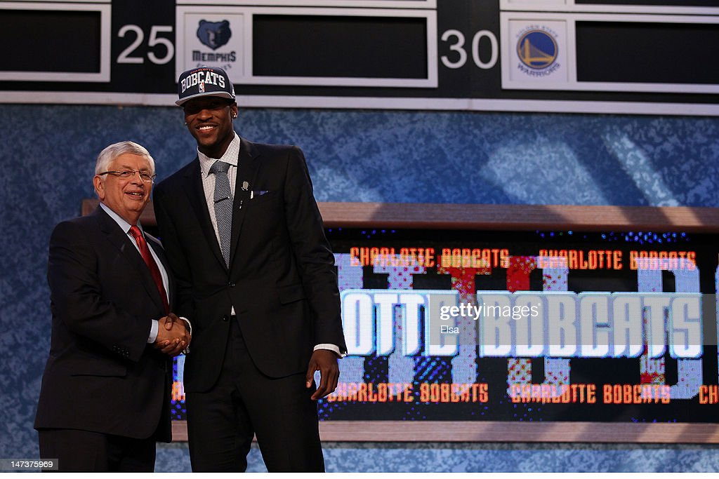 Michael Kidd-Gilchrist (R) of the Kentucky Wildcats greets NBA Commissioner David Stern (L) after he was selected number two overall by the Charlotte Bobcats during the first round of the 2012 NBA Draft at Prudential Center on June 28, 2012 in Newark, New Jersey.