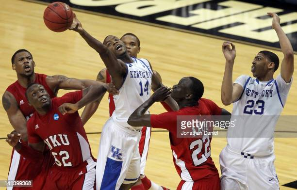 Michael KiddGilchrist of the Kentucky Wildcats reaches for a rebound against TJ Price and Teeng Akol of the Western Kentucky Hilltoppers during the...