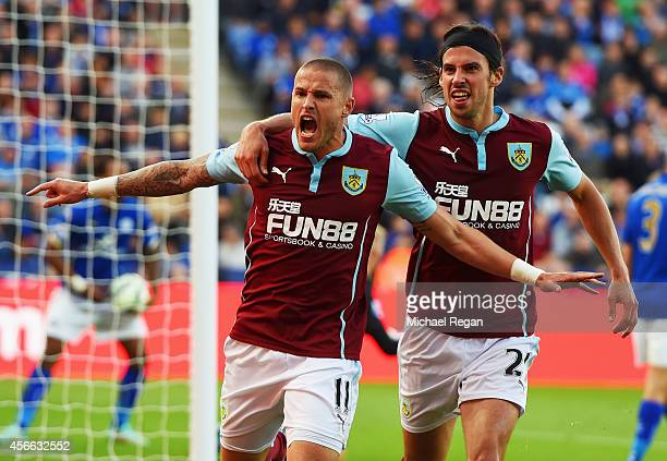 Michael Kightly of Burnley celebrates with George Boyd as he scores their first goal during the Barclays Premier League match between Leicester City...
