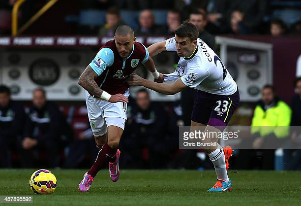 Michael Kightly of Burnley in action with Seamus Coleman of Everton during the Barclays Premier League match between Burnley and Everton at Turf Moor...