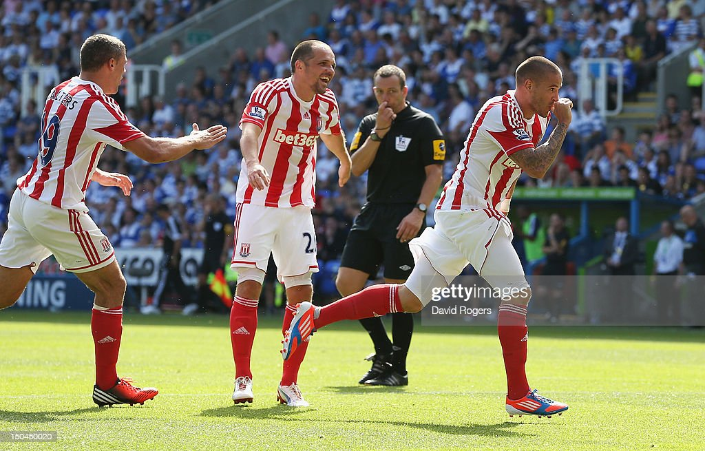 Michael Kightly (R) of Stoke City celebrates scoring the opening goal during the Barclays Premier League match between Reading and Stoke City at Madejski Stadium on August 18, 2012 in Reading, England.