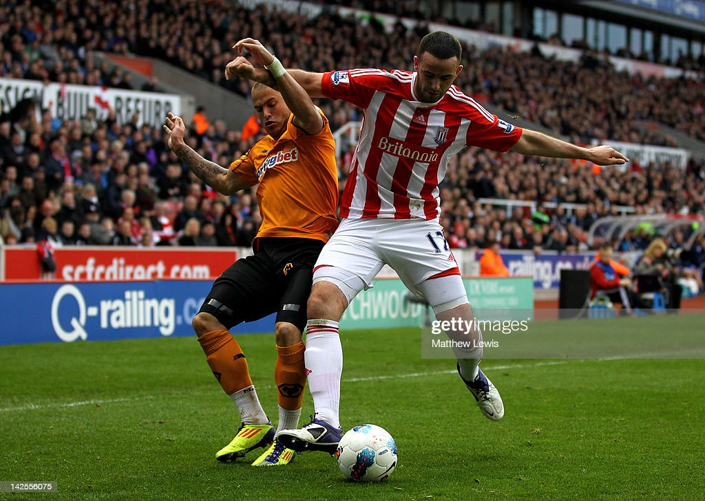 Michael Kightly of Wolverhampton Wanderers tangles with Marc Wilson of Stoke City during the Barclays Premier League match between Stoke City and Wolverhampton Wanderers at the Britannia Stadium on April 7, 2012 in Stoke on Trent, England.