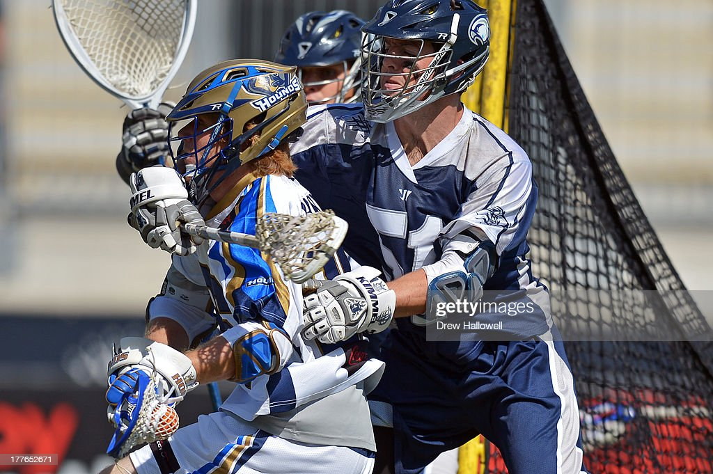 Michael Kimmel #51 of the Chesapeake Bayhawks checks John Haus #26 of the Charlotte Hounds during the MLL Championship at PPL Park on August 25, 2013 in Chester, Pennsylvania.