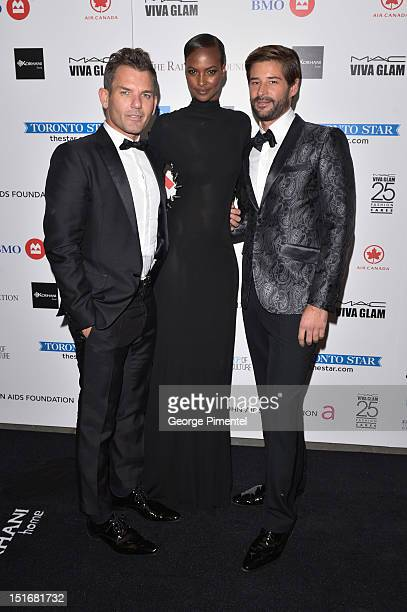 Michael King model Yasmin Warsame and David Hew attends Fashion Cares A Night Of Glitter Light Featuring Elton John Gala at Sony Centre For...
