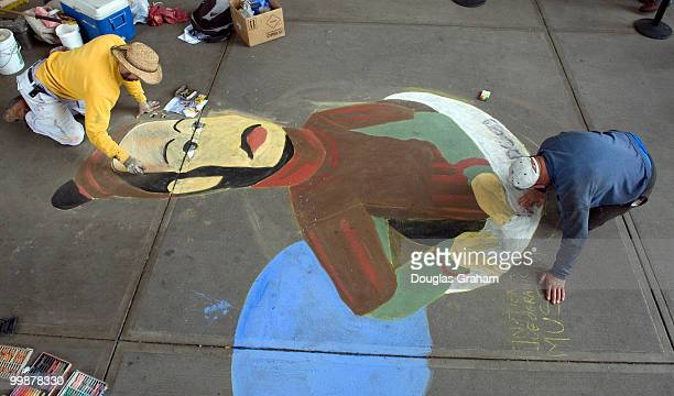 Michael Kirby and his dad Harry with Ambient Planet work an a sidewalk mural of a Terra Cotta Warrior guardians of China's First Emperor The mural is...
