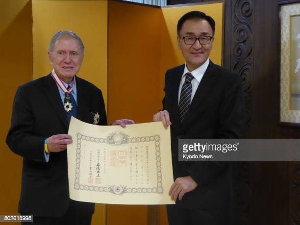 Michael Kirby former chairman of the UN Commission of Inquiry on North Korea poses with Japanese Consul General Keizo Takewaka in Sydney on June 28...