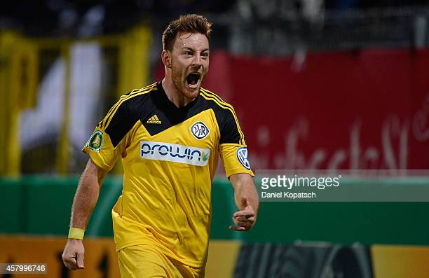 Michael Klauss of Aalen celebrates his team's second goal during the DFB Cup second round match between VfRAalen and Hannover 96 at ScholzArena on...