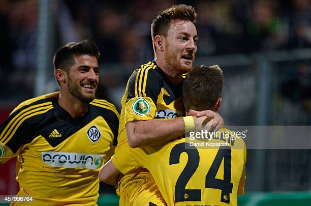 Michael Klauss of Aalen celebrates his team's second goal with team mate Dominick Drexler during the DFB Cup second round match between VfRAalen and...
