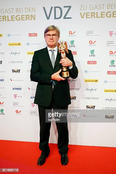 Michael Kleinemeier poses with the 'Entrepreneur of the year' prize during the VDZ Publishers' Night 2016 at Deutsche Telekom's representative office...